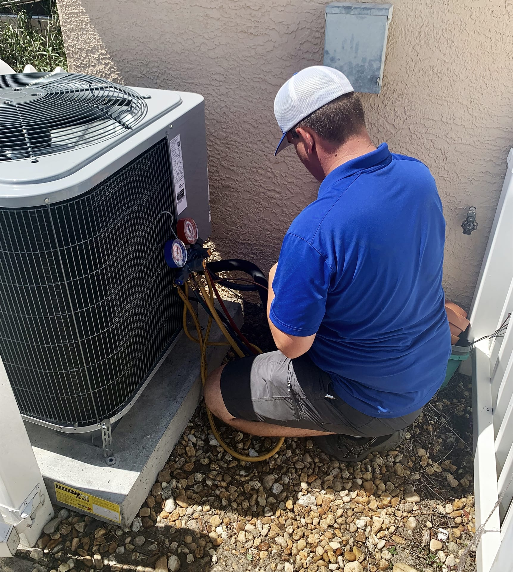 cool rays ac technician completing service call to home