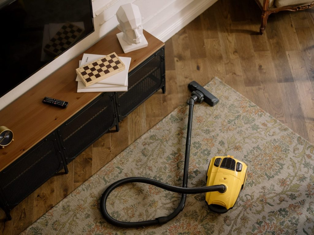 vacuum cleaner resting on top of a rug